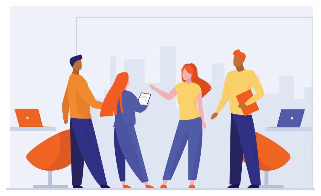 Pessoas conversando, representa a comunicação no local de trabalho.
